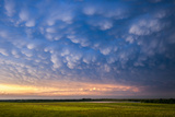 A Supercell Thunderstorm Produces Spectacular Mammatus Clouds at Sunset Photographic Print by Jim Reed