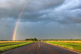 A Thunderstorm Produces a Vivid Rainbow Next to a Rain-Soaked Paved Road Photographic Print by Jim Reed