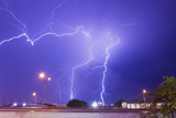 Multiple Lightning Bolts Stike from an Intense Lightning Thunderstorm Photographic Print by Mike Theiss