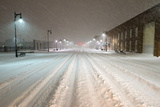A Snowstorm Strikes a City in the Middle of the Night Photographic Print by Jim Reed