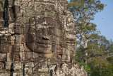 A Serene Face Carved into the Exterior Wall of Bayon Temple, at Angkor Wat Photographic Print by Erika Skogg