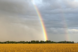 A Thunderstorm Produces a Double Rainbow Photographic Print by Jim Reed