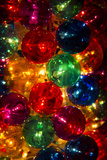 A Stack of Colorful Illuminated Christmas Ornaments Photographic Print by Stephen St. John