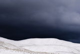 A Powerful Winter Storm Approaches Snow-Covered Mountains Photographic Print by Jim Reed