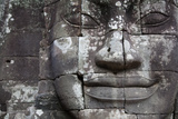 Close Up of a Serene Face Sculpted into an Exterior Wall of Bayon Temple, Angkor Wat Photographic Print by Erika Skogg