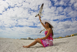 A Laughing Gull Swoops Down for a Cookie in a Woman's Hand at the Beach Photographic Print by Mike Theiss