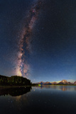 The Night Sky over the Grand Teton National Park and the Jackson Lake Dam Photographic Print by Babak Tafreshi