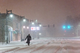 A Man Trudges Through Deep Snow on His Way to Work During a Predawn Snowstorm Photographic Print by Jim Reed