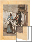 A Man Stands with a Veiled Woman and Child Sitting on a Donkey Wood Print by Unknown Unknown