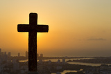 A Cross with the Cartagena Skyline in the Distance at Sunset Photographic Print by Mike Theiss
