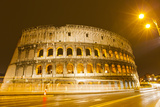 The Ancient Roman Colosseum Casts an Illuminated Golden Light Photographic Print by Mike Theiss