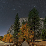 A Moonlit Scenic of a Footbridge on the Merced River, with Planet Jupiter, in Taurus Overhead Photographic Print by Babak Tafreshi