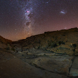 View of the Milky Way Above a Small Canyon in the Atacama Desert Photographic Print by Babak Tafreshi