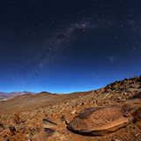 The Milky Way Above an Ancient Petroglyph in the Desert Photographic Print by Babak Tafreshi