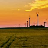 Wind Turbines Spin in a Rape Field Photographic Print by Babak Tafreshi