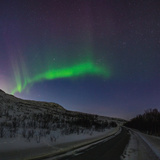 View of the Aurora Borealis, Northern Lights, over a Road Photographic Print by Babak Tafreshi