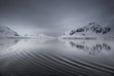 Icebergs and Mountains Reflected in a Rippled Surface of the Ocean Photographic Print by Jim Richardson