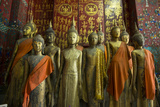 Bronze Statues Inside Wat Xieng Thong Monastery Photographic Print by Michael Melford