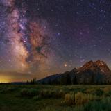 The Milky Way over the Teton Range Fotografisk tryk af Babak Tafreshi