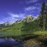 The Teton Range Appear over Jenny Lake, One of the Many Lakes of the Park Photographic Print by Babak Tafreshi