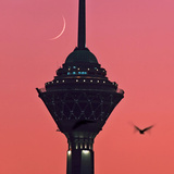 A New Moon Above the Milad Telecommunication Tower Photographic Print by Babak Tafreshi