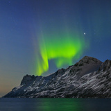 View of the Aurora Borealis, Northern Lights, Reflected in a Fjord Photographic Print by Babak Tafreshi