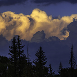 Cumulus Clouds Lit by the Setting Sun at the Grand Teton National Park Photographic Print by Babak Tafreshi