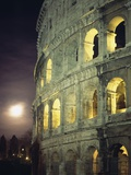 Coliseum at Night with Full Moon Photographic Print by  Design Pics Inc