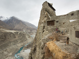Below the Altit Fort and Above the Hunza River, a Woman Tends to Her Potato Field Photographic Print by Matthieu Paley
