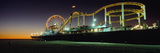 Rollercoaster and Ferris Wheel at Dusk on the Santa Monica Pier Photographic Print by  Design Pics Inc