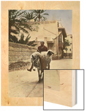 A Man and a Sheep Both Ride a Donkey Through the Streets Wood Print by Eric Keast Burke