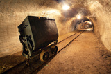 Underground Train in Mine, Carts in Gold, Silver and Copper Mine. Photographic Print by  TTstudio