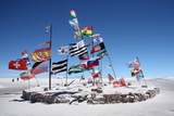 Flags in a Salt Desert of Salar De Uyuni Photographic Print by  jjspring