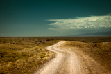 Empty Rural Road Going through Prairie under Cloudy Sky in Charyn Canyon Photographic Print by Perfect Lazybones
