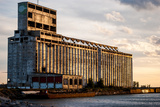 Derelict Grain Elevator on Industrial Pier at Sunset Photographic Print by  oliverjw