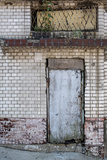 Grunge Brick Wall with Old Door Photographic Print by  KitzCorner