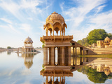 Indian Landmarks - Gadi Sagar Temple on Gadisar Lake - Jaisalmer, Rajasthan Photographic Print by  pzAxe