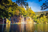 Majestic View on Waterfall with Turquoise Water and Sunny Beams in the Plitvice Lakes National Park Photographic Print by Leonid Tit