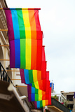 Rainbow Flags on Houses Photographic Print by  JackF