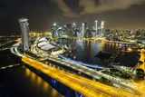 Singapore Skyline at Night Seen from Singapore Flyer Photographic Print by Paul Souders