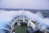 Waves Breaking over the Bow of a Ship Photographic Print by  DLILLC