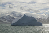 Iceberg with Mountain Range in Background Photographic Print by  DLILLC
