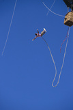 Man Bungee Jumping from a Hot Air Balloon Photographic Print by  DLILLC