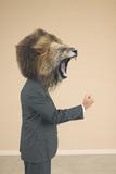 Lion Headed Businessman Roaring Photographic Print by  DLILLC