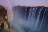 Rainbow over Waterfall Photographic Print by  DLILLC