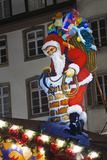 Santa Claus Sign in Christmas Market Photographic Print by Jon Hicks