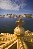 An Ornamental Crown of the Skeppsholmsbron, with Gamla Stan across the Water Photographic Print by Jon Hicks