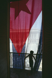 Boy Standing by Cuban Flag Photographic Print by  DLILLC