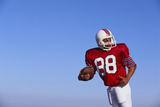 Football Player Photographic Print by  DLILLC