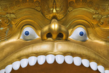 Detail of Statue over Entrance to Buddhist Museum at the Golden Temple Photographic Print by Jon Hicks